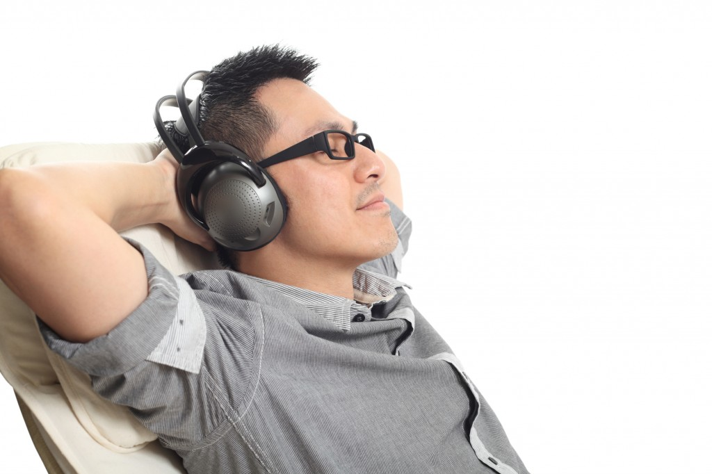 Listen to music, relax, get your dental implants in NYC